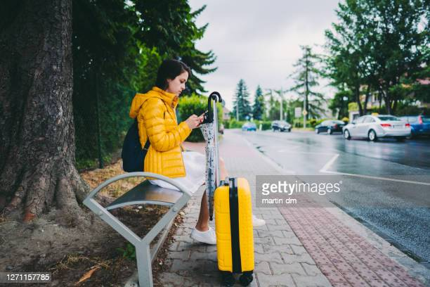 tourist waiting at the bus stop - nomadic people stock pictures, royalty-free photos & images