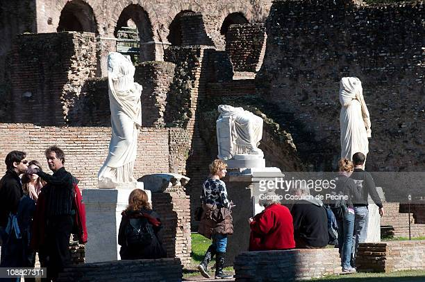 Tourist walk in the house of the Vestal Virgins in the archaeological area of the Roman Forum on February 4 2011 in Rome Italy The House of the...