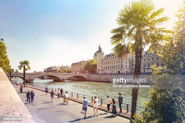Tourist walking along the coastal walk on the banks of the Seine river in Paris, France. 01 September 2018.