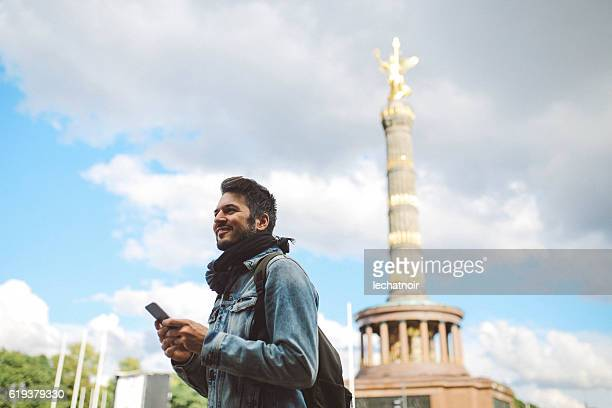 Tourist walking by the Berlin Victory column