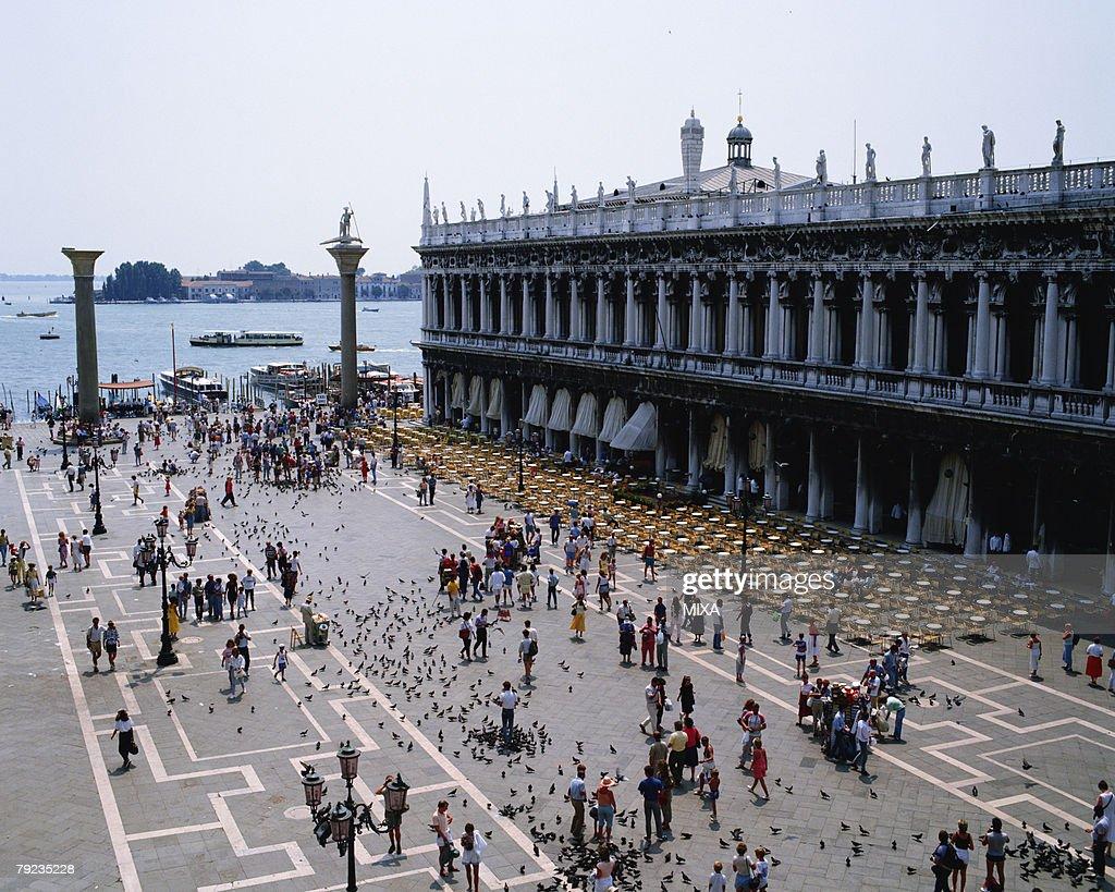 Tourist walking in St. Mark's Square in Venice, Italy : Stock Photo
