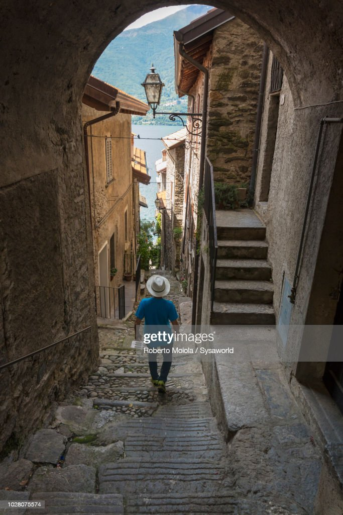 Tourist walking in the medieval town : Stock Photo