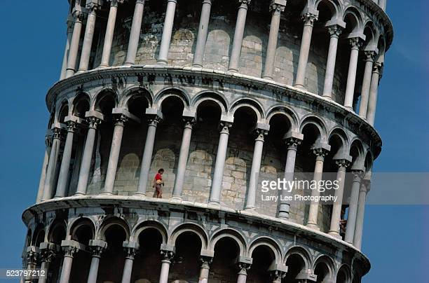 Tourist Walking on Leaning Tower of Pisa