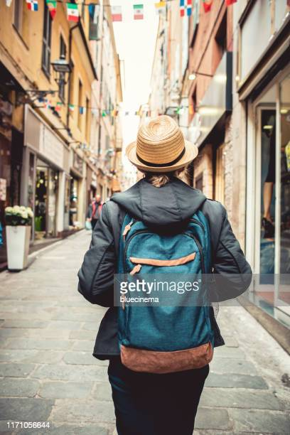 tourist walking on the street san remo - san remo italy stock pictures, royalty-free photos & images