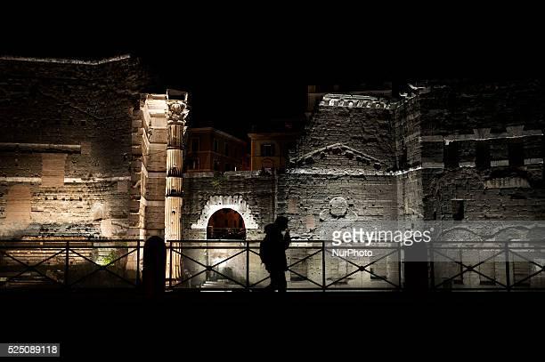 A tourist walking on Via dei Fori Imperiali in Rome Italy on November 30 2015 on November 30 2015 in Rome Italy