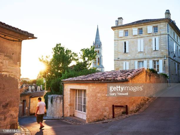 tourist walking the streets of saint-emilion. - france stock pictures, royalty-free photos & images