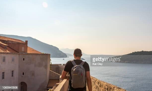 Tourist walking the walls of Dubrovnik