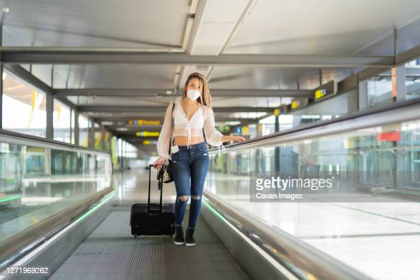 tourist walking through the airport - fare stock pictures, royalty-free photos & images