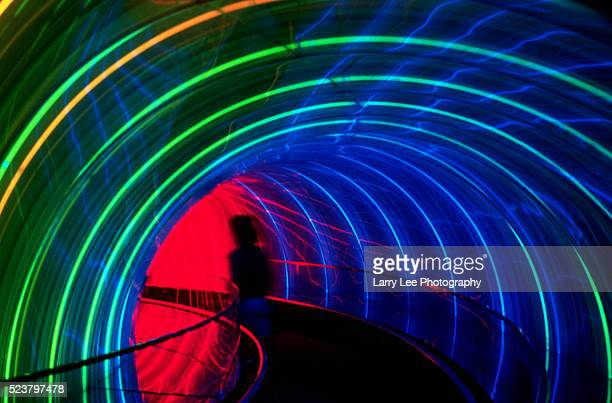 Tourist Walking Through Tunnel at EPCOT Center