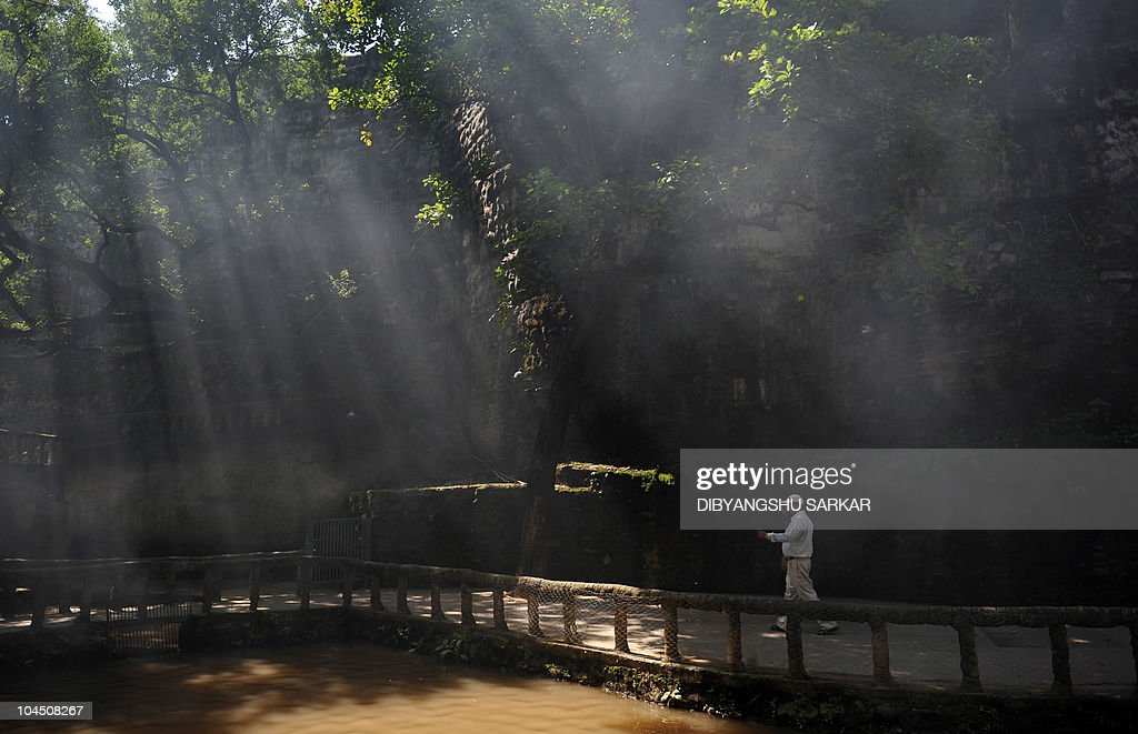 A tourist walks along a bridge in the Rock Garden in Chandigarh on September 28 2010 Rock Garden of Chandigarh is a sculpture garden founded by Nek...