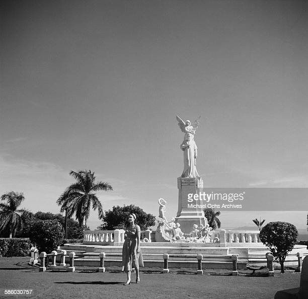 A tourist walks by the monument of Ruben Dario near the Plaza de le Revolution in Managua Nicaragua