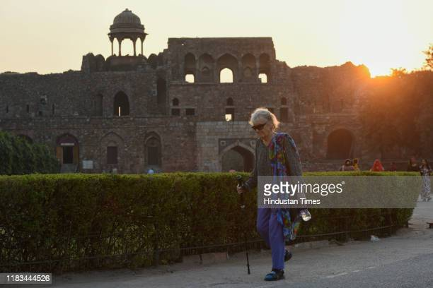 A tourist walks during dusk at Purana Qila on November 19 2019 in New Delhi India Archaeological Survey of India is celebrating Heritage Week from...