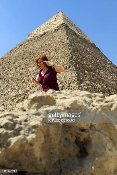 A tourist walks in front the Great Pyramid of Khafre in Giza on March 30 2010 AFP PHOTO/KHALED DESOUKI