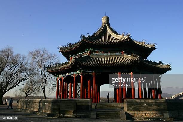 A tourist walks in the Bafang Pavilion at the Summer Palace a famous classic imperial garden on December 15 2007 in Beijing China Beijing will be the...