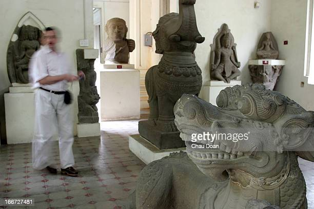 A tourist walks inside the Cham museum in Danang The dragon sculptures in the foreground are made in 13th century The Museum of Champa Sculpture was...