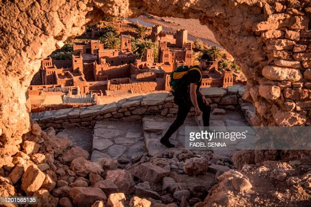 A tourist walks near the Kasbah of AitBenHaddou where scenes depicting the fictional city of Yunkai from the hit HBO television series Game of...