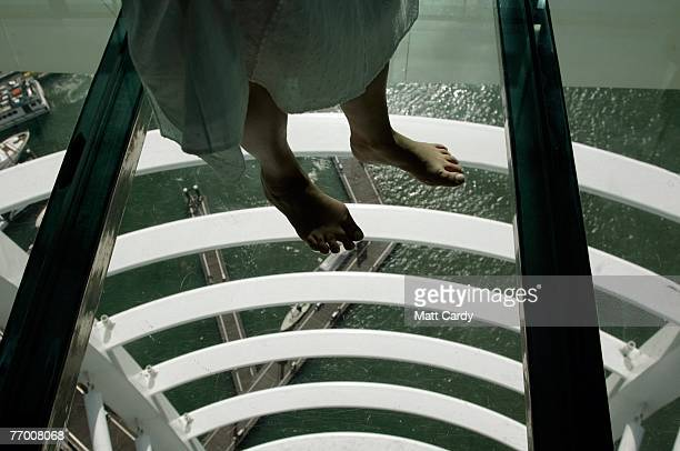 A tourist walks on glass panels in the Spinnaker Tower viewing gallery on September 25 2007 in Portsmouth England The 170m tall tower which offers...
