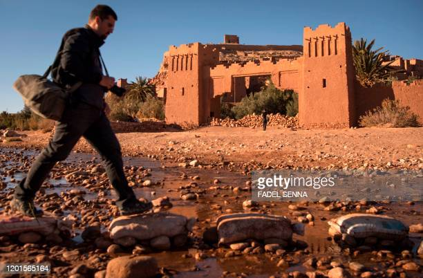 A tourist walks past the Kasbah of AitBenHaddou where scenes depicting the fictional city of Yunkai from the hit HBO television series Game of...