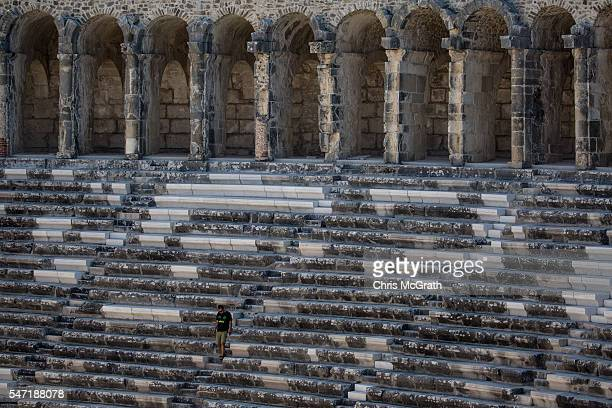 A tourist walks the steps of a roman theater of the ancient city of Aspendos on July 12 2016 in Antalya Turkey Russian President Vladimir Putin last...