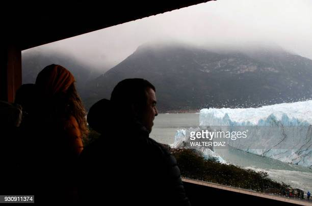 Tourist watch from a shelter the Perito Moreno glacier at Parque Nacional Los Glaciares near El Calafate in the Argentine province of Santa Cruz on...