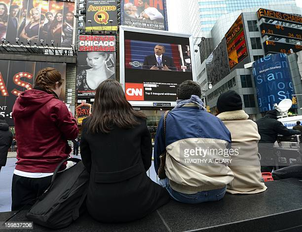 Tourist watch on a Jumbotron in Times Square in New York as US President Barack Obama takes the oath of office during the 57th Presidential...