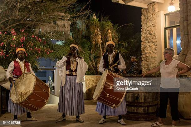 A tourist watches on during a traditional dance performance at a restaurant on June 30 2016 in Djerba Tunisia Before the 2011 revolution tourism in...