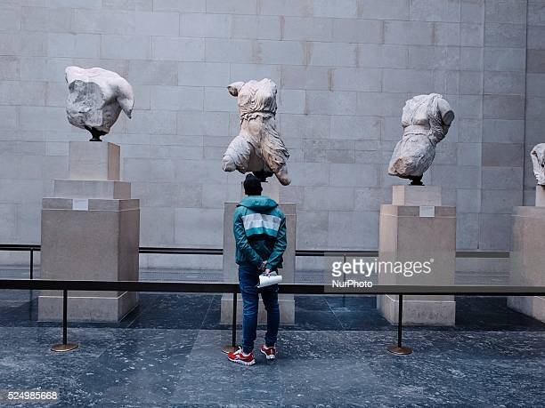 A tourist watches the Parthenon Marbles in British museum The marbles were removed by Lord Elgin and carried from Greece to England