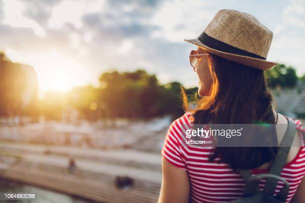 tourist watching sunset on the riverbank - waterfront stock pictures, royalty-free photos & images