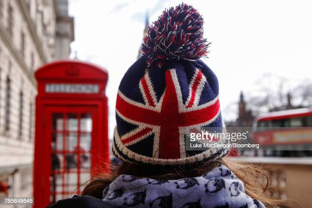 A tourist wearing a hat with the British Union flag