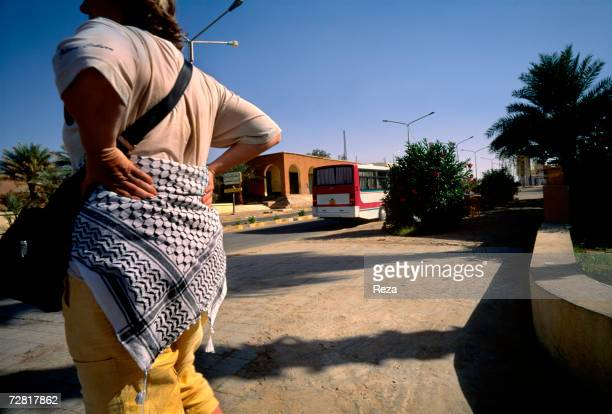 A tourist wears a kaffiyeh around her hips April 2000 in Ghadames Libya