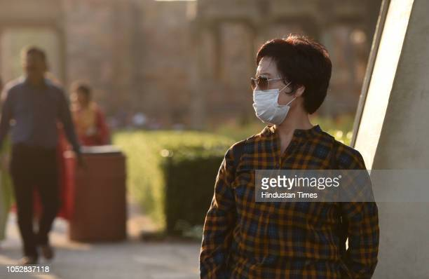 A tourist wears mask to protect himself from the pollution at Qutab Minar on October 23 2018 in New Delhi India The air quality of Delhi continued to...