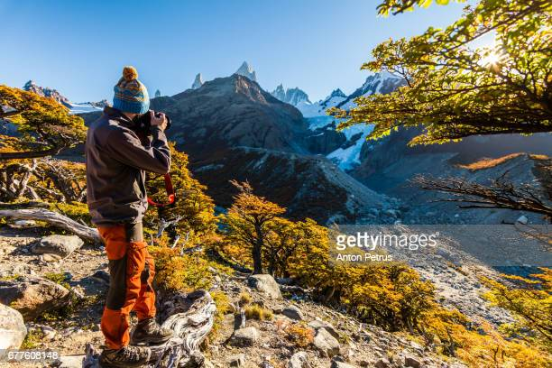 tourist with a camera on a background of mountains. patagonia, argentina - anton petrus stock pictures, royalty-free photos & images