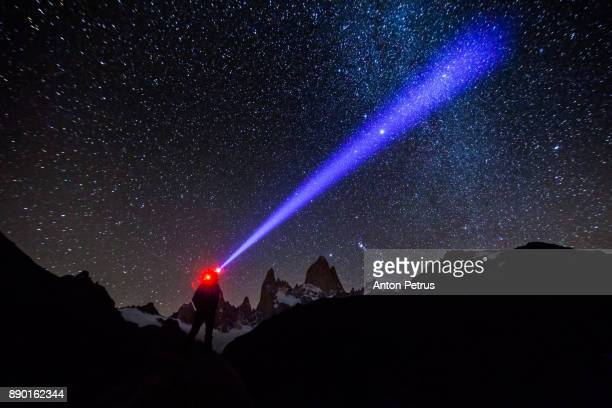 Tourist with a flashlight against the starry sky. Argentina, Patagonia