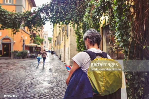 tourist with a map walking the streets of rome - rome stock pictures, royalty-free photos & images