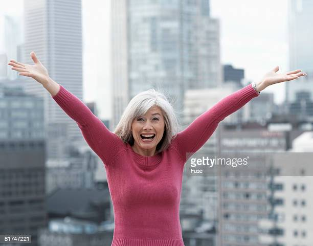 tourist with arms raised - only mature women stock pictures, royalty-free photos & images
