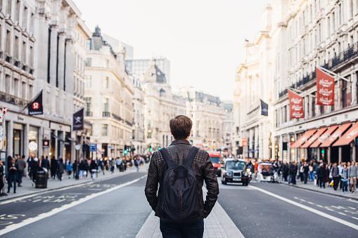 Tourist with backpack walking on Regent Street in London, UK - gettyimageskorea
