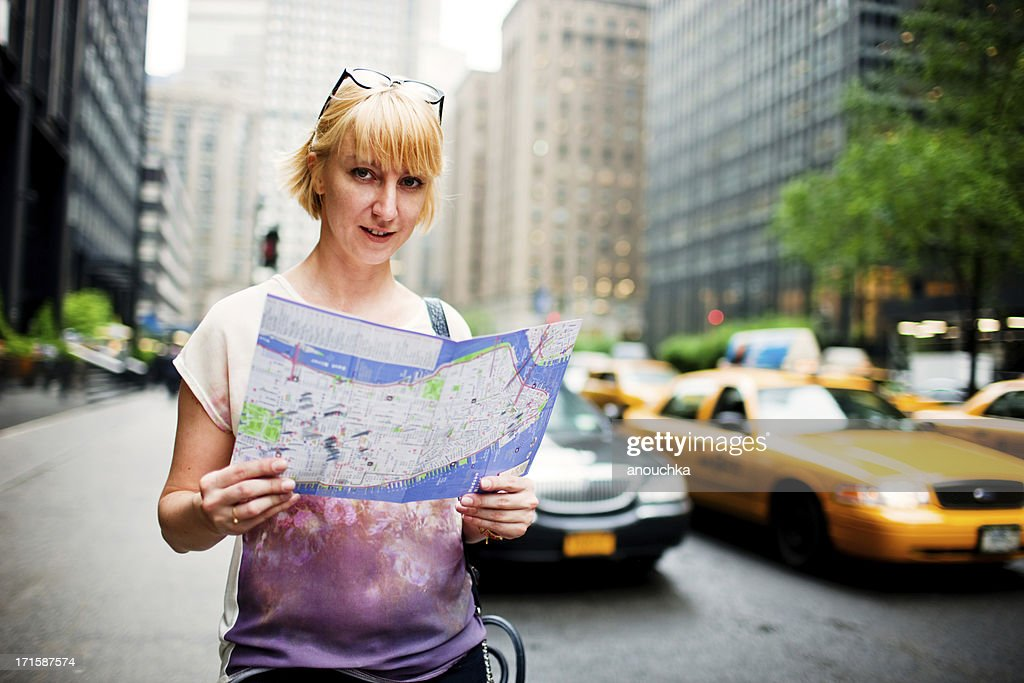Tourist with city map on New York Street : Stock Photo