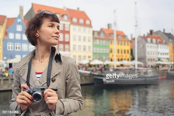 Tourist with mirrorless camera in Nyhavn, Copenhagen.