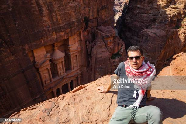 tourist with the al-khazneh treasury tomb in the city of petra viewed from above. - place concerning death stock pictures, royalty-free photos & images