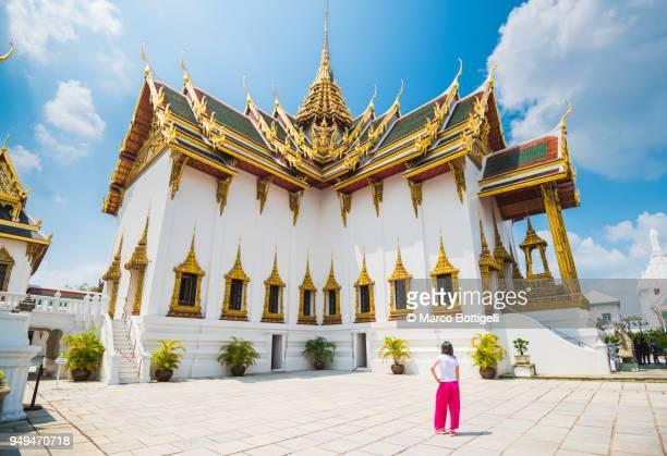 Tourist woman admiring the architecture at Royal Palace, Bangkok, Thailand