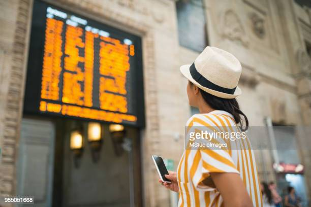 tourist woman at the train station. - railroad station stock pictures, royalty-free photos & images