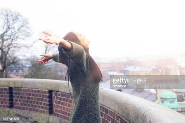 Tourist woman enjoys the trip; Kärnan castle in Helsingborg, Sweden