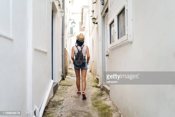 tourist woman explores parga - epirus greece stock pictures, royalty-free photos & images