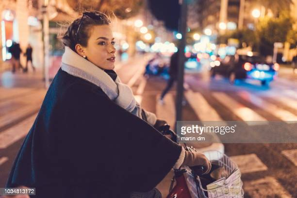 tourist woman exploring barcelona on bicycle - one young woman only stock pictures, royalty-free photos & images
