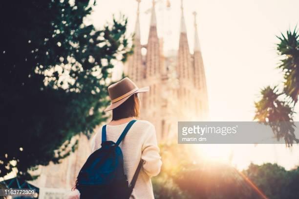 tourist woman exploring bracelona - unesco world heritage site stock pictures, royalty-free photos & images