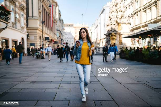 tourist woman exploring vienna - pedestrian zone stock pictures, royalty-free photos & images