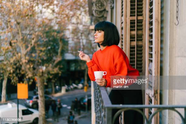 tourist woman in barcelona - beautiful women smoking cigarettes stock pictures, royalty-free photos & images