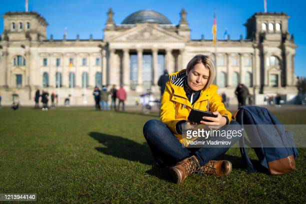 tourist woman in berlin - bundestag stock pictures, royalty-free photos & images