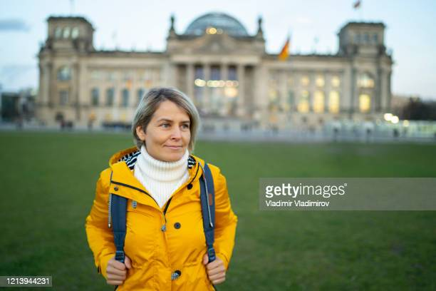 tourist woman in berlin - national landmark stock pictures, royalty-free photos & images