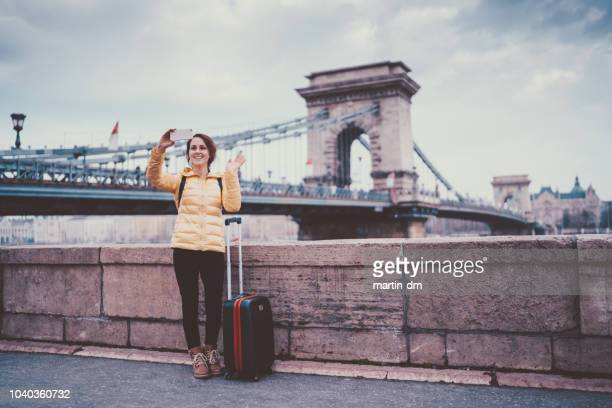 tourist woman in budapest - wheeled luggage stock photos and pictures